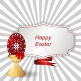与装饰品的红色复活节彩蛋在支持,与丝带的一个标记 库存照片