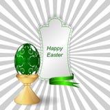 与装饰品的绿色复活节彩蛋在支持,与丝带的一个标记 免版税图库摄影