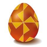 与装饰品风车的复活节金黄鸡蛋 库存照片