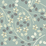 与装饰花和叶子的逗人喜爱的无缝的样式 免版税库存照片