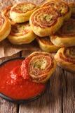 与西红柿酱关闭的被切的土豆卷 垂直 免版税库存照片