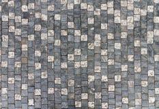 与规则设计的花岗岩铺有鹅卵石的路面背景 免版税库存照片