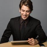 微笑的年轻商人 库存图片