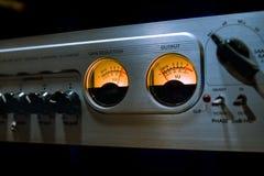 与许多按钮和vu米的混音器调平器在recordin 免版税库存图片