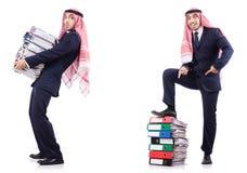 与许多文件夹的阿拉伯商人在白色 库存图片
