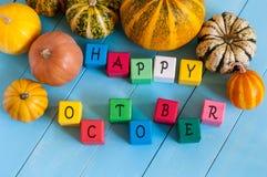 与许多色的愉快的10月木块 免版税库存图片