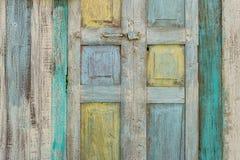 与许多颜色和背景的老木头 库存照片