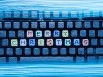 与词圣诞快乐的键盘色的钥匙 免版税库存照片