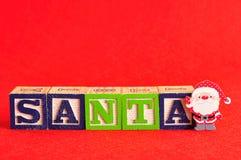 与词圣诞老人的圣诞老人 库存照片