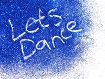 与词的深蓝闪烁闪闪发光在白色背景我们跳舞 库存图片