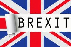 与词brexit的英国英国英国旗子在被剥去的被撕毁的纸 库存照片