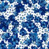 与豹子印刷品和蓝色花的五颜六色的无缝的样式 库存照片