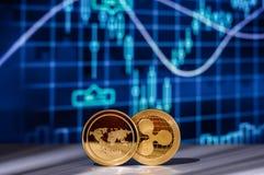 与财政图的Cryptocurrency硬币在背景 免版税库存图片