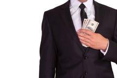 与货币的生意人 库存照片