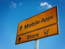 与购物车和smartphone的移动apps路标。 库存图片