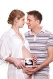与超声波照片的愉快的怀孕的系列 库存照片