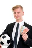 与足球和金钱的年轻商人 免版税库存照片
