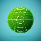 与足球场的绿草球形在蓝色清楚的背景 免版税库存照片