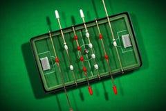 与足球的微型表橄榄球赛 库存照片
