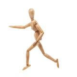 与跑的姿势的木人模型 库存照片