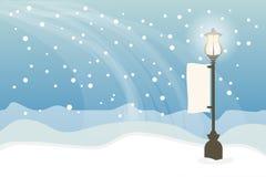与路灯柱,圣诞节背景的斯诺伊 库存图片