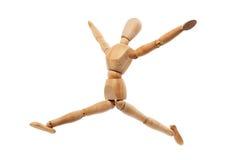 与跳跃的姿势的木模型 库存照片