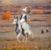 与车手的马狩猎在女骑装 免版税图库摄影