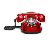 与轮循拨号的一老红色telephon 免版税库存图片