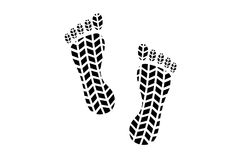 与轮胎踩样式的脚印 免版税库存照片