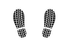 与轮胎踩样式的鞋子脚印 免版税库存照片