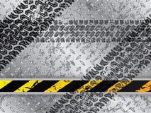与轮胎轨道的抽象背景 图库摄影