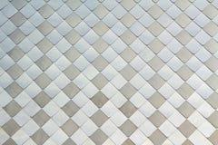 与轻和黑暗的正方形的马赛克背景 库存图片
