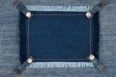 与边缘的牛仔布框架和有假钻石的四条传送带 免版税库存照片