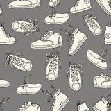 与运动鞋的无缝的模式 传染媒介葡萄酒手拉的textu 图库摄影