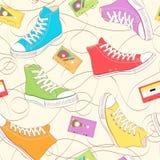与运动鞋的无缝的模式 库存照片
