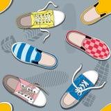 与运动鞋的无缝的模式 库存图片