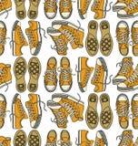 与运动鞋的无缝的模式 免版税库存照片