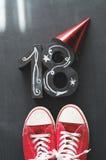 与运动鞋的第18个生日概念 免版税库存图片
