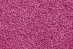 与迷离作用的桃红色颜色毛巾表面特写镜头 库存图片