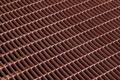 与迷离作用的红颜色mtal栅格地板 免版税库存照片