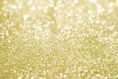 与选择聚焦的金子闪烁 库存照片
