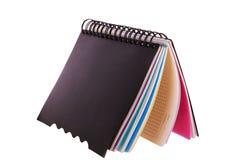 与选项分切器的空白螺旋学校笔记本 库存照片