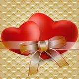 与透明丝带的两红色心脏 库存图片
