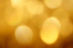 与透镜火光作用的抽象黄色背景 免版税图库摄影