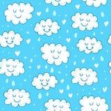 与逗人喜爱的云彩的蓝色无缝的样式 免版税图库摄影