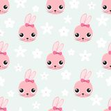 与逗人喜爱的兔子面孔的无缝的样式 库存例证