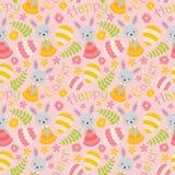 与逗人喜爱的兔宝宝、花和鸡蛋的样式在桃红色背景 免版税图库摄影