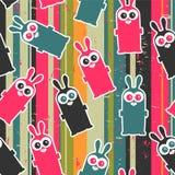 与逗人喜爱的兔宝宝的无缝的背景 免版税库存照片