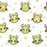 与逗人喜爱的绿色妖怪面孔的无缝的样式 库存图片
