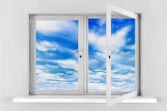 与通过被打开的塑料窗口被看见的云彩的蓝天 免版税图库摄影